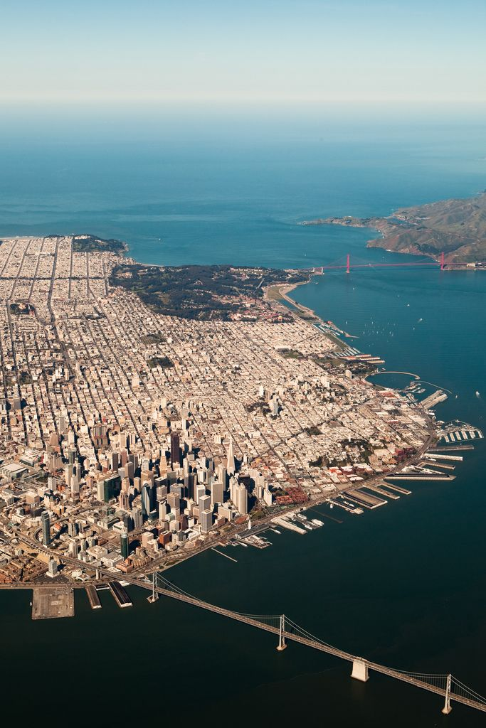 San Francisco, CA. See the Golden Gate Bridge at the mouth of the Bay and the Bay Bridge from Oakland in the foreground by MattRaygun https://www.flickr.com/photos/bukanza/ #sanfrancisco #california #usa #goldengate #oakland